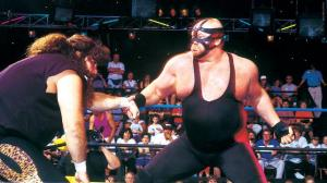 Vader handing out punishment to Cactus Jack.