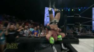 A sick piledriver by Young on Jarrett onto a ladder.